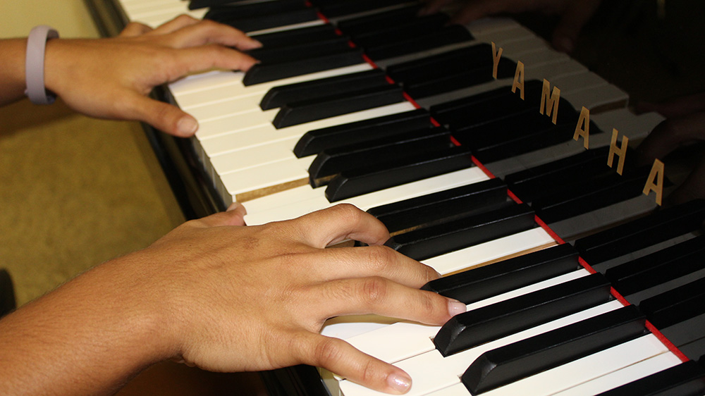 image of hands playing the piano