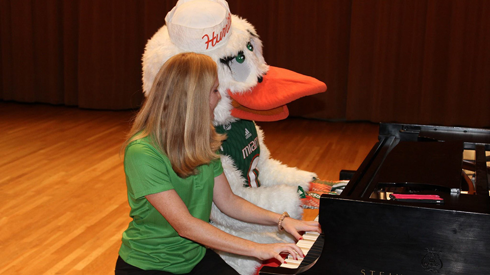 Sebastian and student playing the piano