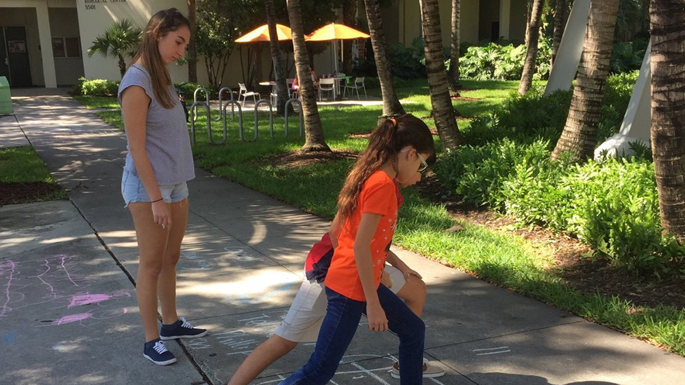 students play hopscotch on campus