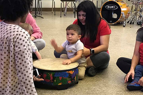 Young student learning about drums
