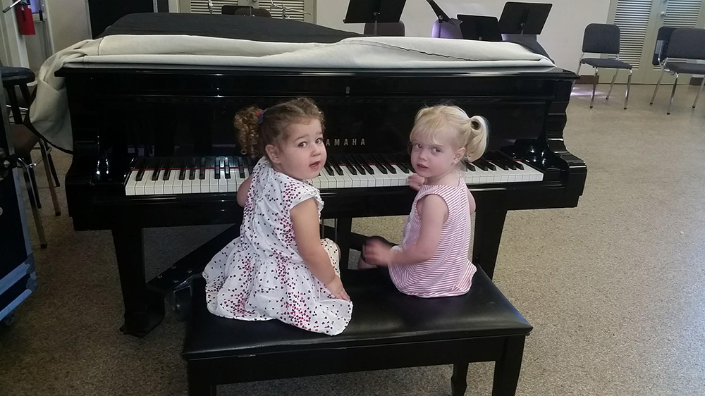 little canes enjoying time at the piano