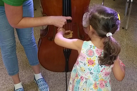 Child learning about a new instrument