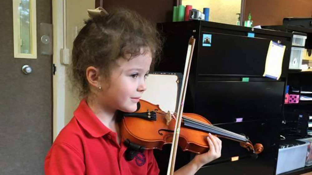 student practices the violin