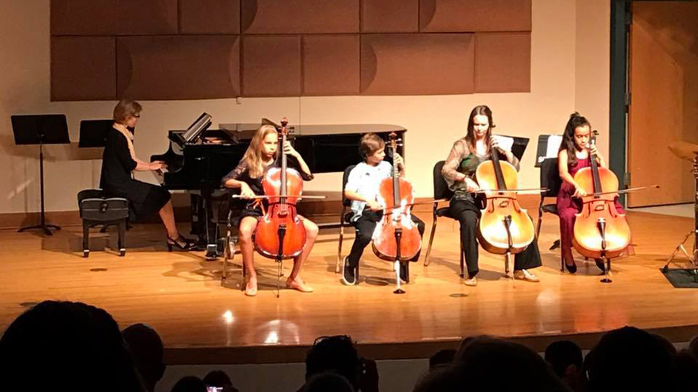 student strings group performs on stage